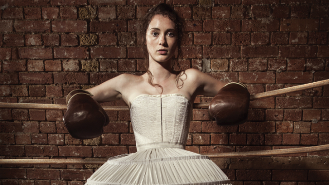 Victorian female boxer in a ring